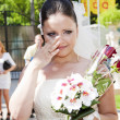 Stock Photo: Emotional bride holding floral bouquet bridal