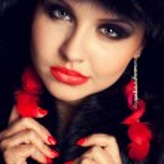 Beautiful young woman wearing fur hat — Stock Photo
