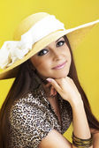 Smiling girl wearing a hat — Stock Photo