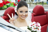 Portrait of the bride sitting in the car — Stock Photo