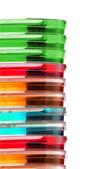 Renkli petri yemekler izole yığını — Stok fotoğraf