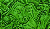 Abstract background green silk fabric with waves — Stock Photo