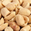Processed pea nuts background — Stock Photo