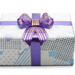 Gift box with big bow ribbon — Stock Photo