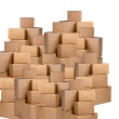 Piles of cardboard boxes on a white background — Stock Photo #8550312