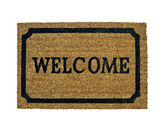 A new welcome doormat isolated — Stok fotoğraf