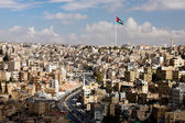 View of the city of Amman with Jordanian flags — Stock Photo