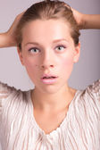 Portrait of attractive young woman looking shocked isolated on w — Stock Photo