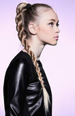 Woman with blonde hair plait in profile — Stock Photo