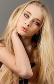 Blond woman portrait with long beautiful hair and smoky eyes — Stock Photo