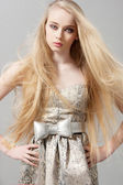 Young woman with long blonde hair in fashion dress — Stock Photo