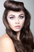 Sexy brunette woman with fancy hairstyle — Stock Photo