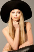 Blond woman with long beautiful hair and smoky eyes in a hat. St — Stock Photo