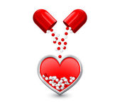 Capsule is divided in half pours red white granules in the heart — Stock Photo