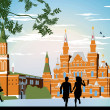 Boy and girl running in the red Square hand in hand — Stock Photo