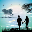 Couple holding hands on the beach going on the ocean — Stock Photo