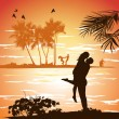 Man embraces woman on the shore of the beach at sunset — Stock Photo