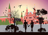 Boy and girl holding hands and walking in the Red Square — Stock Photo