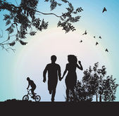 Boy and girl running through the park holding hands — Stock Photo