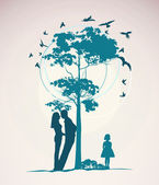 Couple standing near a tree — Stock Photo