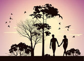 Husband and wife holding hands and walking in the park — Stock Photo