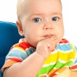 Little baby girl is sitting at the table — Stock Photo #10122983