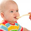 Little baby is feeding curds from spoon — Stock Photo #10123038