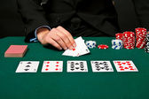 Gambler with cards and chips. — Stock Photo