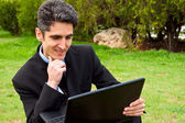 Young man is working on laptop. — Stock Photo