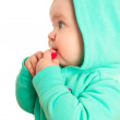 Baby girl in coat with hood — Stock Photo