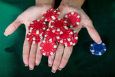 Gambler with chips in hand. — Stock Photo