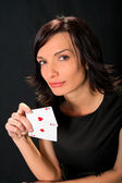 Young lucky gambler with cards — Stock Photo
