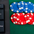 Fragment of black keyboard with gamble chips. — Stok Fotoğraf #10650309