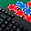 Fragment of black keyboard with gamble chips. — Stock Photo