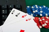 Fragment of black keyboard with gamble chips and cards. — Stock Photo