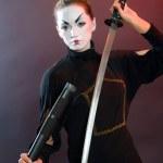 Mystic girl with sword. — Stock Photo