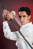 Handsome man with sword — Stock Photo