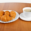 Newly-baked croissants and cup of coffee. — Stock Photo