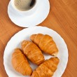 Royalty-Free Stock Photo: Newly-baked croissants and cup of coffee.