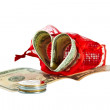 Red straw paper-bag with money in form heart — Stock Photo