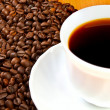 Royalty-Free Stock Photo: Cup of  coffee with coffee beans.