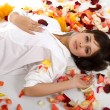 Royalty-Free Stock Photo: Beautiful girl  in rose-petals