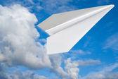 Paper plane in blue sky. — Stock Photo