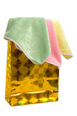 Gold paper-bag and towels. — Stock Photo