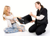 Cheerful loving couple with laptop — Stock Photo