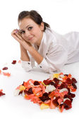 Beautiful girl with rose petals — Stock Photo