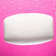 Soap bar on pink abstract background — Stock Photo