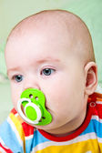 Baby girl with pacifier. — Stockfoto