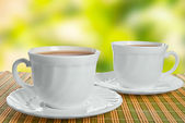 Two teacups on abstract background. — Stock Photo