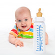 Little baby with milk bottle. — Stock Photo #9784039